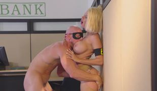 A hot blonde is getting fucked in the bank by the bank robber