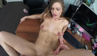 A curly haired blonde is massaging her tender and sexy clit