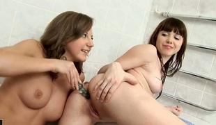 Brunette Inna finds Zhenia hawt and sticks her tongue in her love box