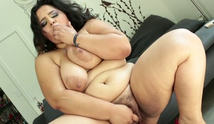 Lustful fattie Karla Lane masturbates with diminutive dildo