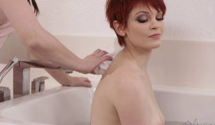 Short-haired redhead getting the oral treatment from her most good friend