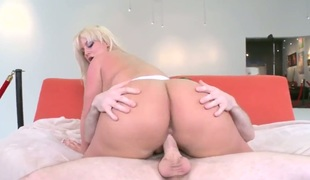 Julie Specie is a golden-haired with a huge ass. She is placing it on top of her lover and her twat slips on his cock. It is so huge it eclipses the whole screen.