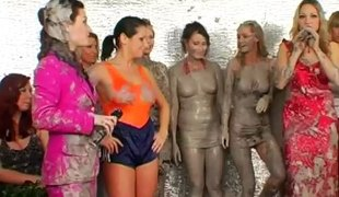 Wrestling in the mud makes two ladies completely obscene