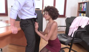 Ebony secretary acquires a long dong inside her face hole and her cunt