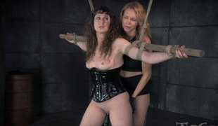 Dominatrix with a strap-on penetrates the beaver of her slave