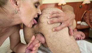 Salacious blonde granny Nanney enjoys arse stab with a hot guy
