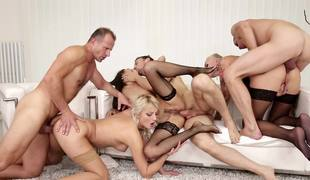 Girls are doing an fuckfest with some men at a swingers party