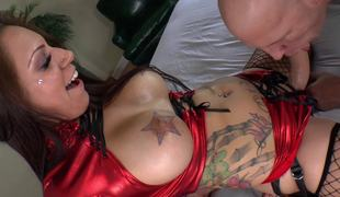 A big arse bitch with tattoos and a thong on is fucking her paramour