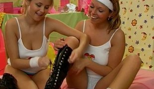 Well graced and cute lesbians have a fun licking and toying their muffs warmly