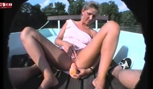 Hairless fur pie fucked by a vibrator on a boat