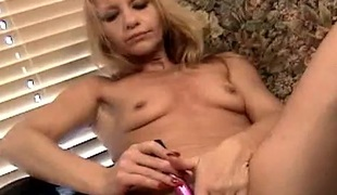 Mamma pleasures with large clitoris with a sex tool