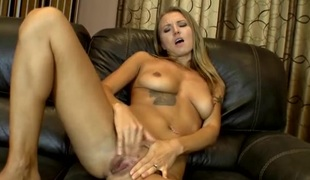 Pierced pussy mom masturbates on the couch