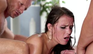 Four men are fucking a hot brunette in a gangbang and she likes it