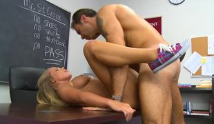 A blonde spreads her open and she acquires her pussy licked in the classroom