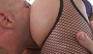Two brunettes riding a big dick in their slits