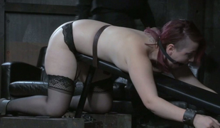 Redhead skank with charming appetizing body spanked with wood