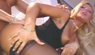 This hot blonde is a true fuck doll and that babe knows how to put on a show