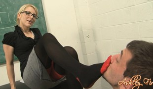 Sexy golden-haired teacher punishes her student by making him eat her vagina