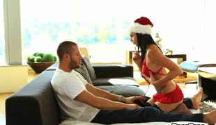 Christmas hottie sucking a candy cane and his big cock