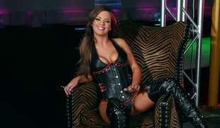 Sizzling brunette hair wearing leather corset and over-the-knee boots Alice Lighthouse masturbates cookie