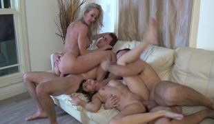 Two gals are with two guys, doing a hot foursome together
