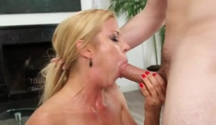 Milf tits are wet with spit during a messy blowjob